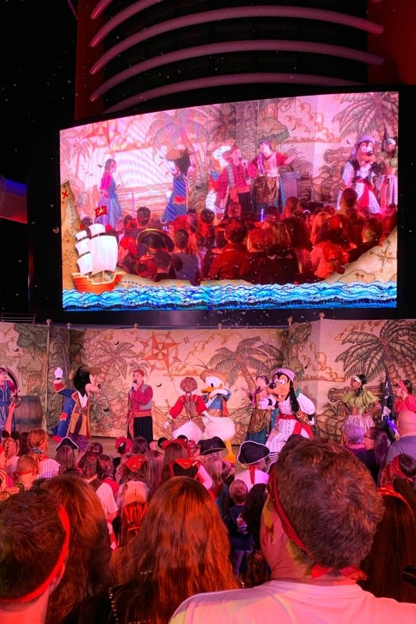 Disney characters presenting a show during pirate night on a cruise