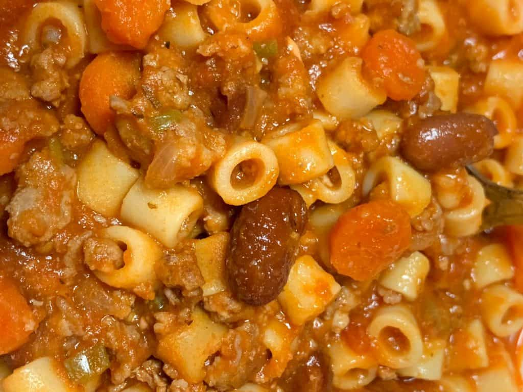 Italian sausage, hamburger, carrots, celery, onions, chunky tomatoes, white beans, kidney beans, and pasta soup