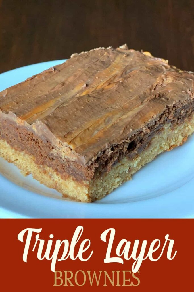 Close up of triple layer brownie on white plate with text