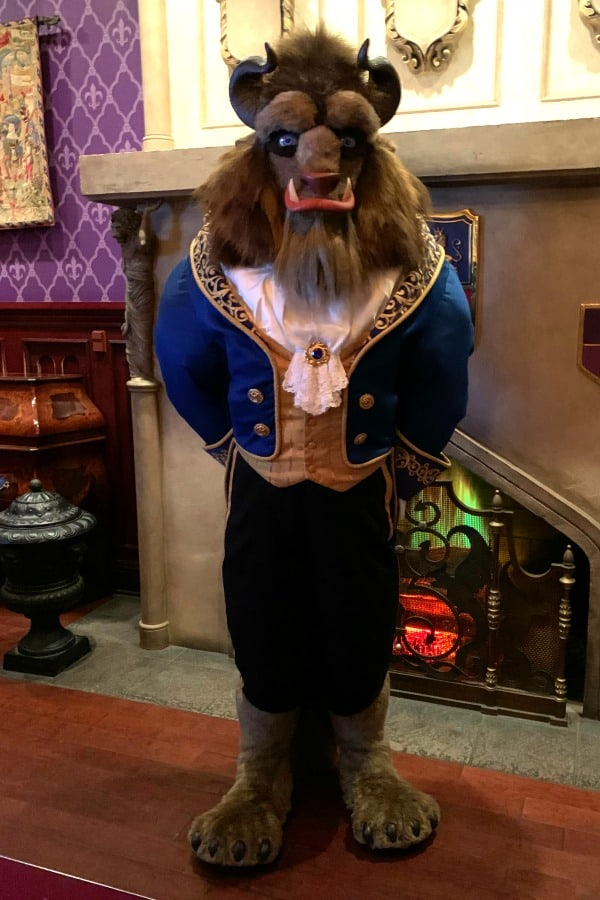 The Beast meeting guests at Be Our Guest Restaurant in Walt Disney World