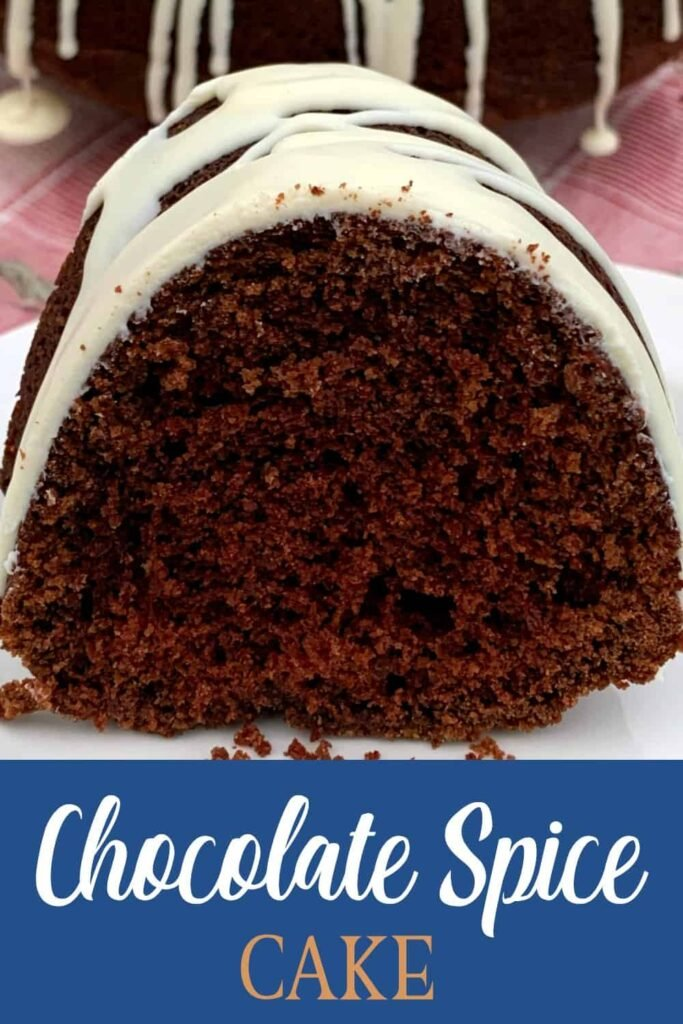 Close-up slice of moist chocolate bundt cake with layer of dried cream cheese icing