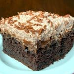 Moist piece of Chocolate Fudge Cake on a white plate with easy chocolate mousse icing