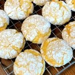 Lemon Cake Mix Cookies rolled in confectioners sugar on cooling rack