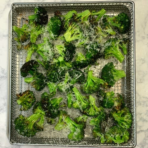 Lightly seasoned toaster oven tray of air fryer broccoli parmesan