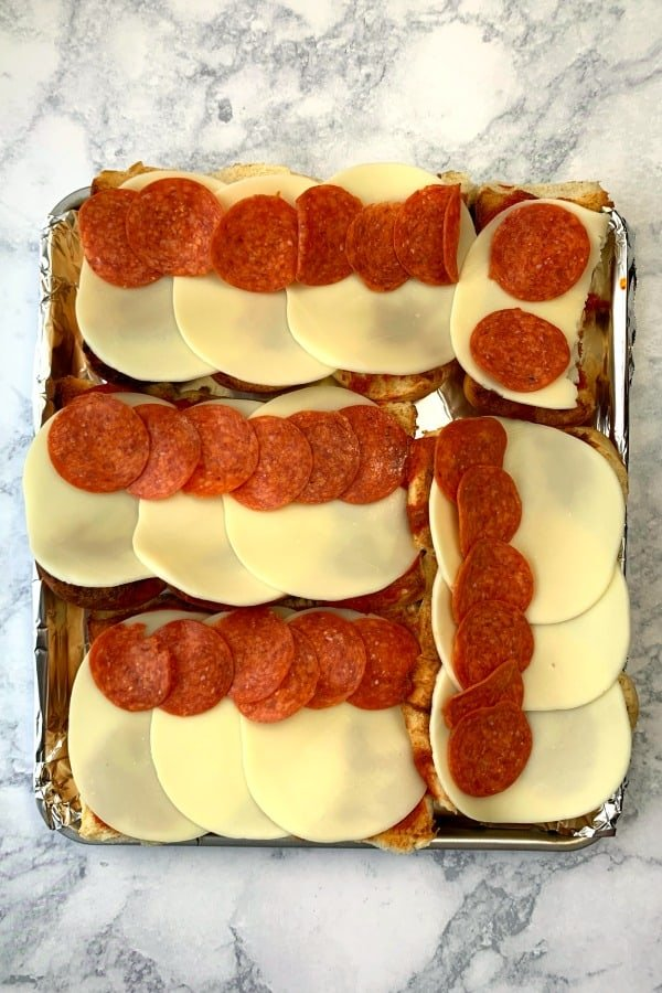 Hawaiian rolls with sauce, cheese and pepperoni to make air fryer pizza sliders or subs