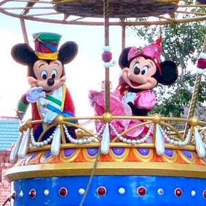 Mickey and Minnie Mouse on float in Magic Kingdom parade