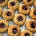 Thumbprint cookies on wire rack filled with jam