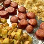 Air Fryer Smoked Sausage & Sauerkraut with potatoes on foil lined tray