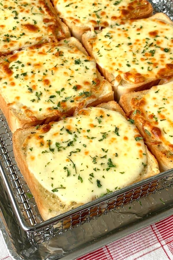 Baked Cheesy Garlic Texas Toast on red plaid napkin