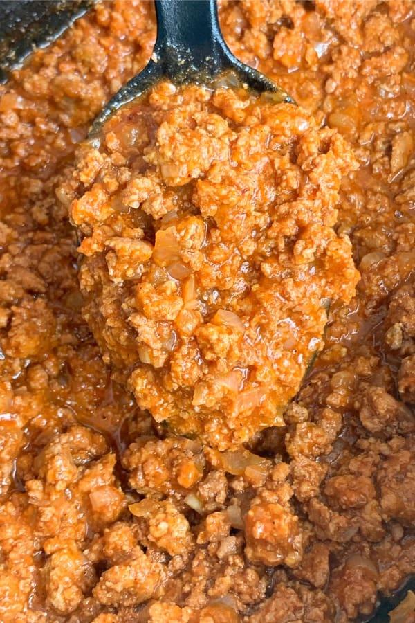 crock pot full of ground beef and sloppy joe sauce for farmhouse sloppy joes