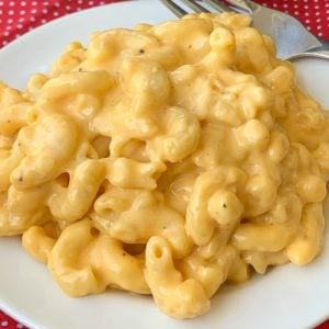 Easy crock pot macaroni and cheese on a white plate