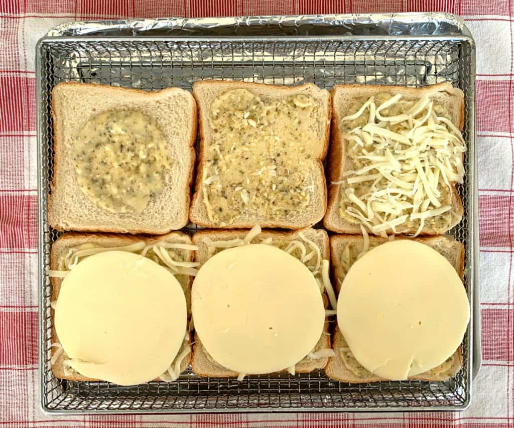 Texas toast in air fryer tray with steps to make buttery, garlic cheesy toast