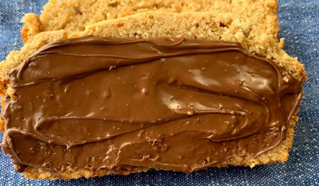 Thick layer of hazelnut spread on peanut butter bread