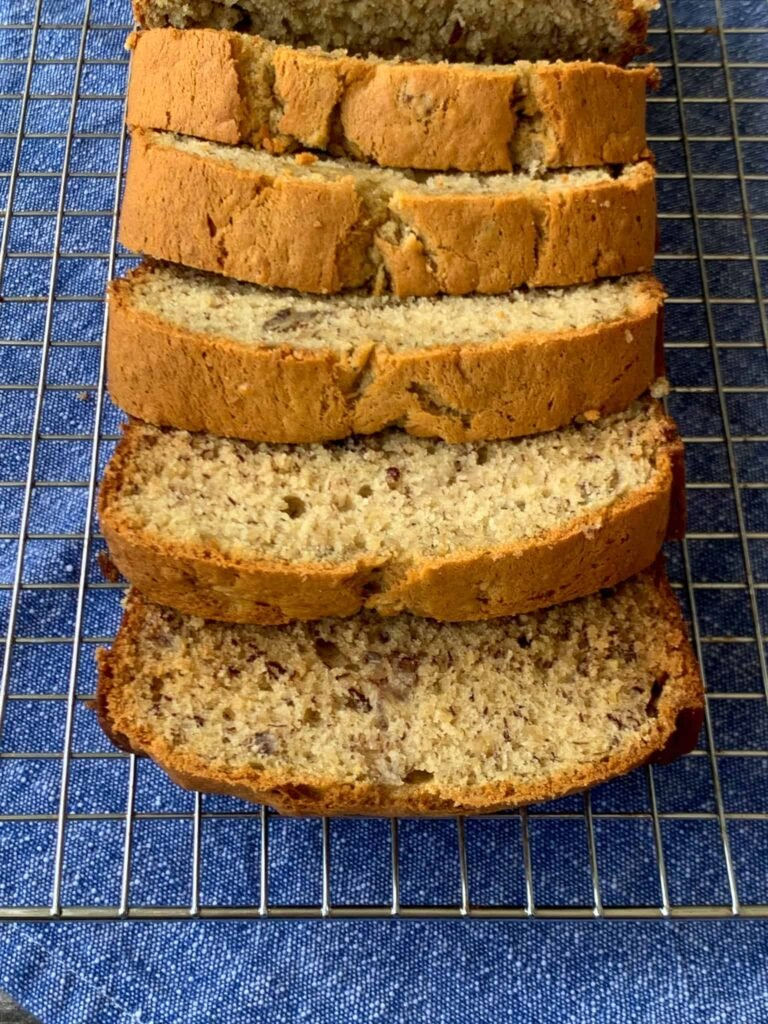 Banana Bread with Pecans sliced on a baking rack
