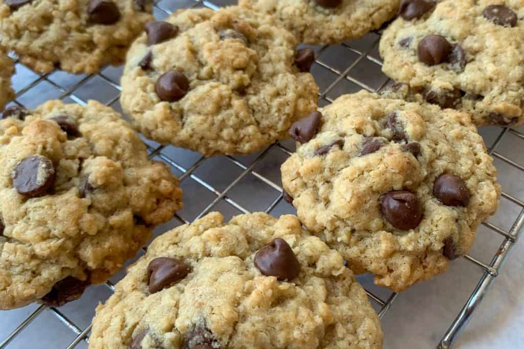 Chocolate chip oatmeal cookies on a cooling rack