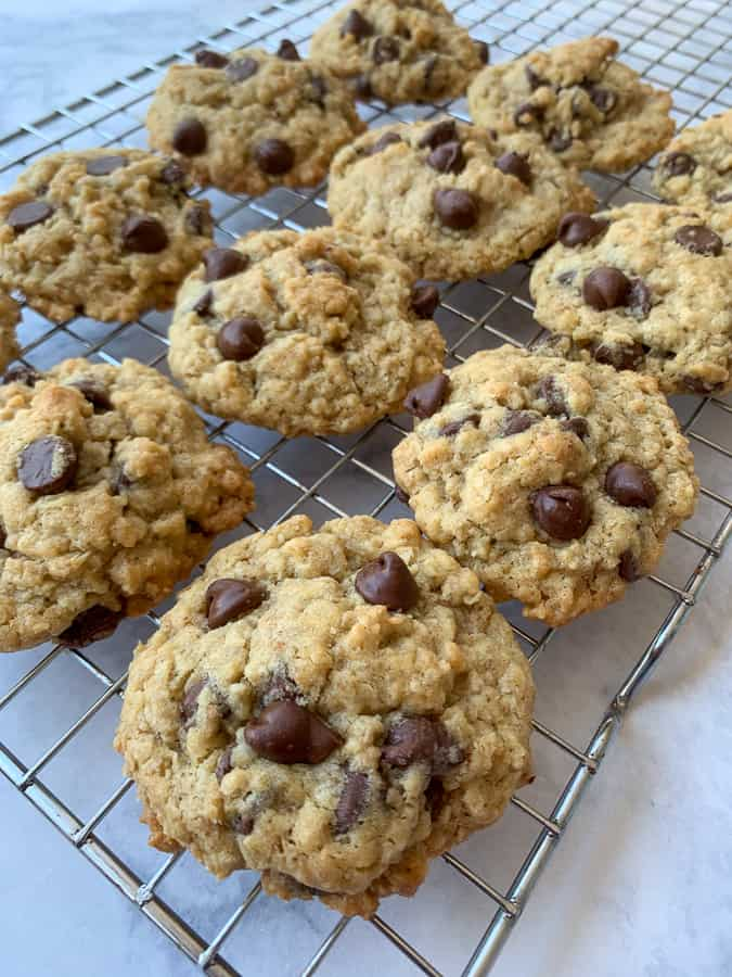 Baking rack full of Farmhouse Oatmeal Chocolate Chip Cookies