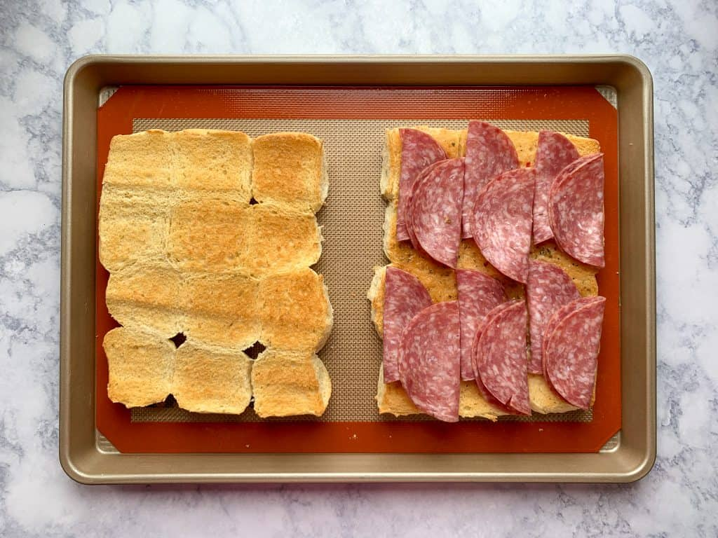 How to fold salami to fit well on Italian sliders on a sheet pan