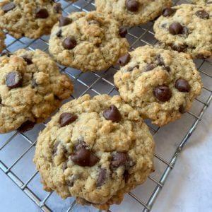 Old-fashioned oatmeal coco chip cookies on cooling rack