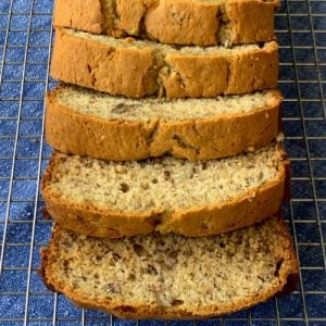 Banana Pecan Bread sliced on a baking rack