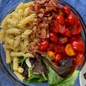 Bowl of rotini pasta salad ingredients