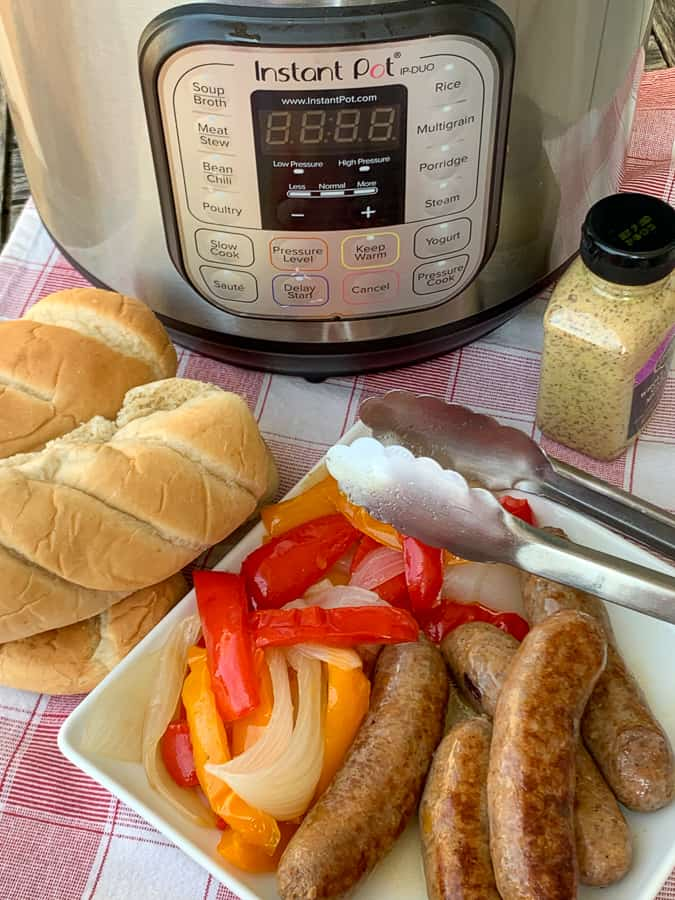 Instant Pot next to sausage rolls, Italian sausage, peppers and onions