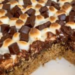 Smores bars with toasted marshmallows, chocolate and a graham cracker crust