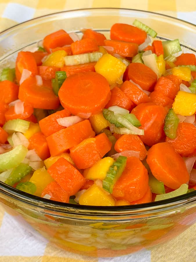Carrot, celery, onion and mango in pickled vegetable salad