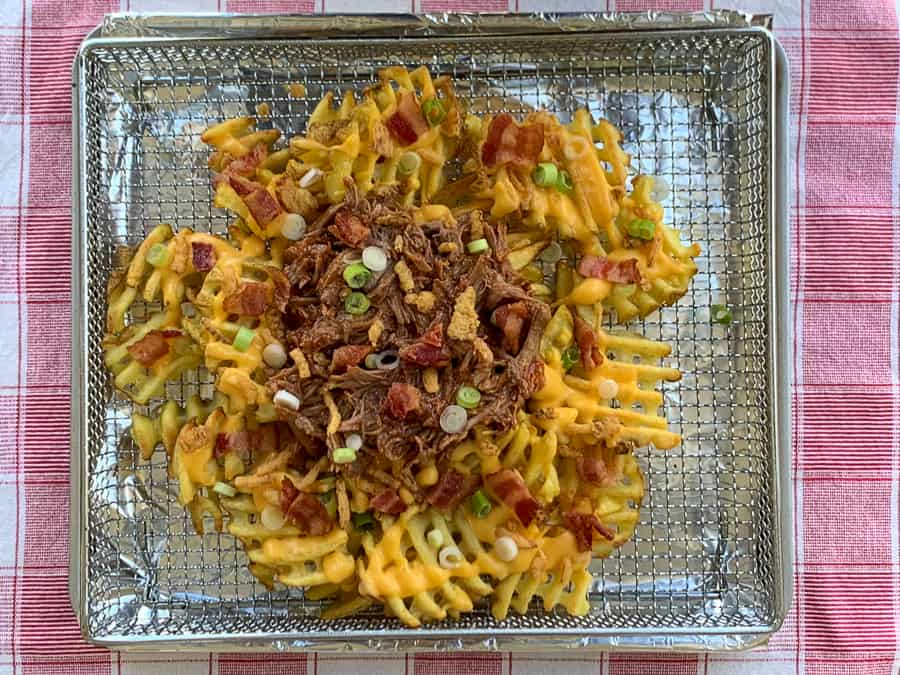 Air fryer toaster oven tray of loaded waffle fries