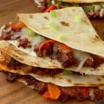 Triangle shared Quesadillas filled with bbq pulled pork, cheese and vegetables