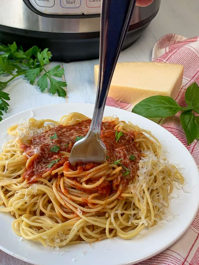 Spaghetti twirled around fork and covered with easy homemade spaghetti sauce