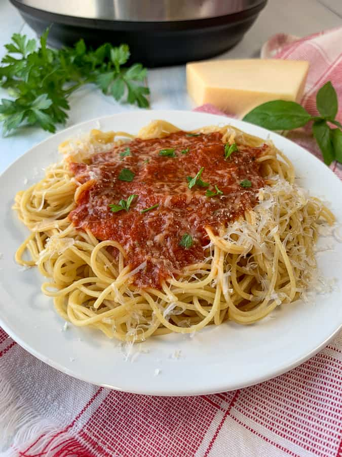 Easy homemade spaghetti sauce with cheese on spaghetti