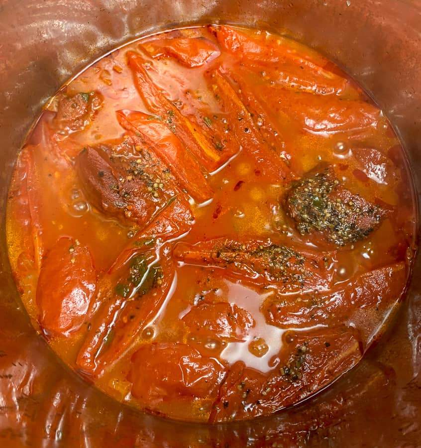 Cooked tomatoes and sauce that need immersion blender to be smooth