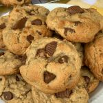 Chocolate chip cookies with peanut butter and chopped Reese's cups