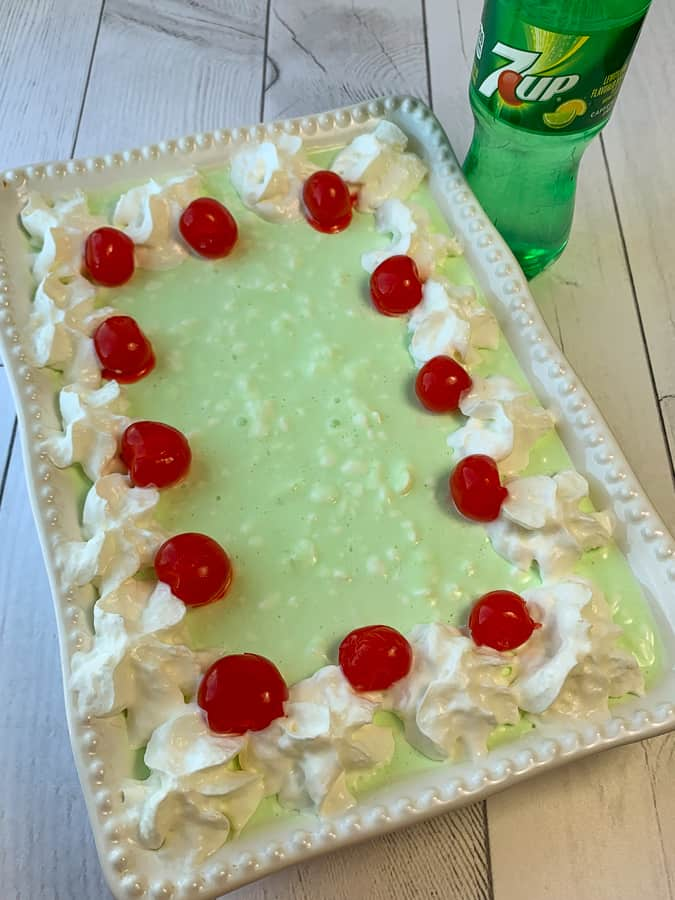 Bottle of 7UP next to classic jello salad in 9 x 13 pan