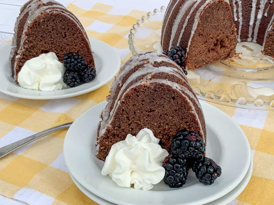 Pieces of easy blackberry cake next to full cake