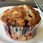 Beautiful blueberry muffin with cinnamon sugar topping on plate