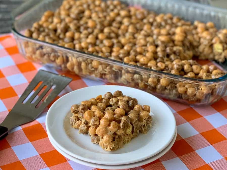 Reeses Puffs cereal bar on plate next to full pan