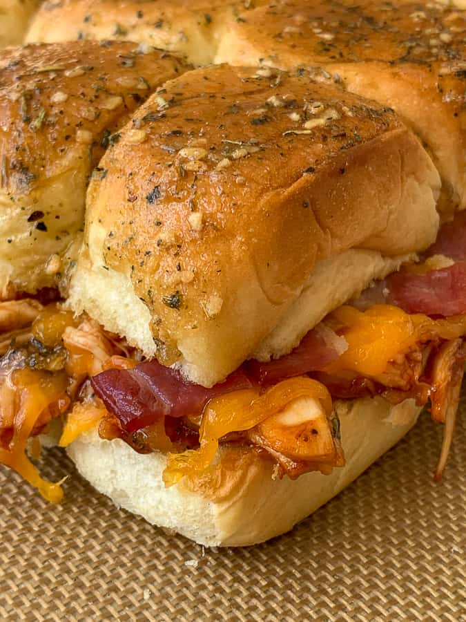 Easy shredded bbq chicken slider loaded with bacon, ranch and cheddar cheese