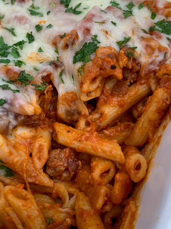 Penne pasta, Italian sausage, red pasta sauce, mozzarella cheese in an easy casserole