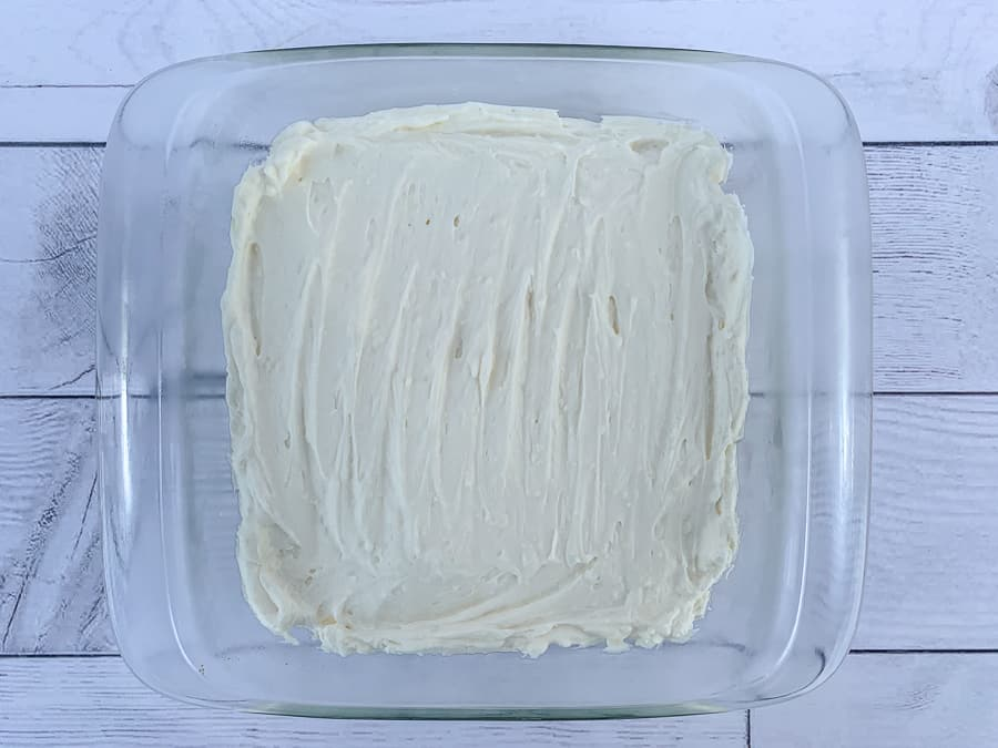 Layer of cream cheese, whipping cream and powdered sugar mixed together and spread on graham cracker crust
