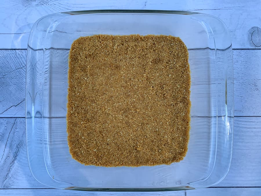 Graham cracker, brown sugar and butter crust pressed in 9 inch square dish