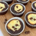 Black and white homemade chocolate cupcakes with cream cheese and chocolate chip filling
