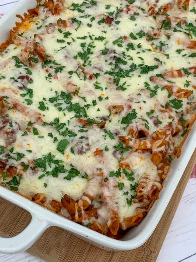 9 x 13 white pan full of cheesy classic baked pasta casserole