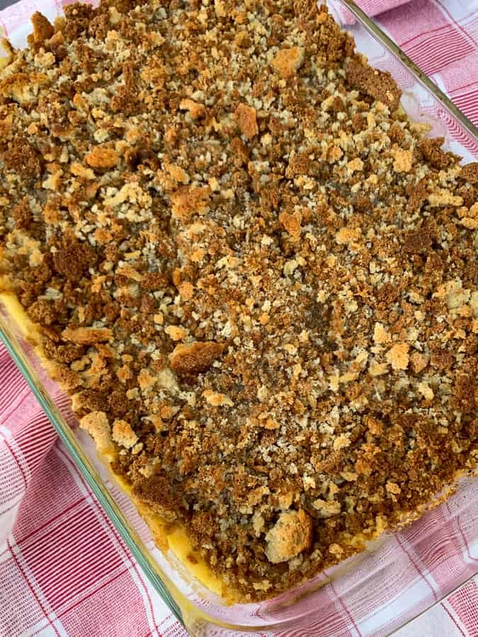Baked pork chop casserole with browned stuffing in 9x13 dish on red plaid napkin