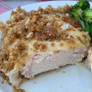 Slice of creamy pork chop casserole on a white plate