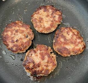 4 homemade sausage patties in a skillet