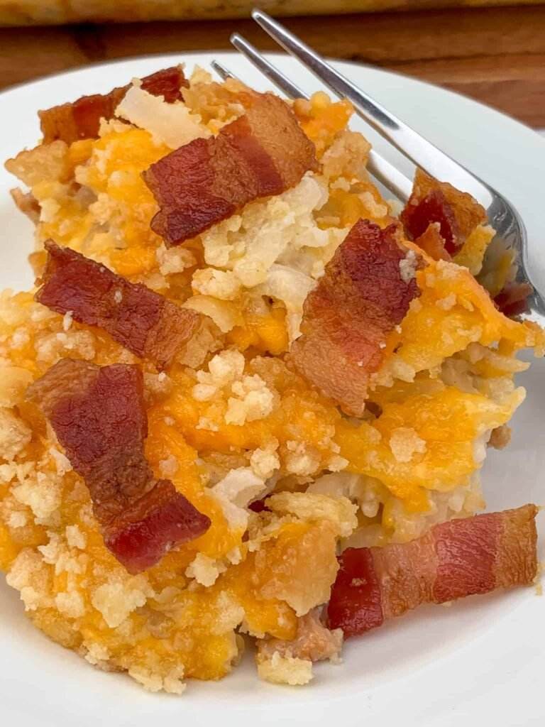 Chopped bacon on and mixed in cheesy hash brown casserole