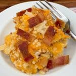 Cheesy bacon hashbrowns with fork