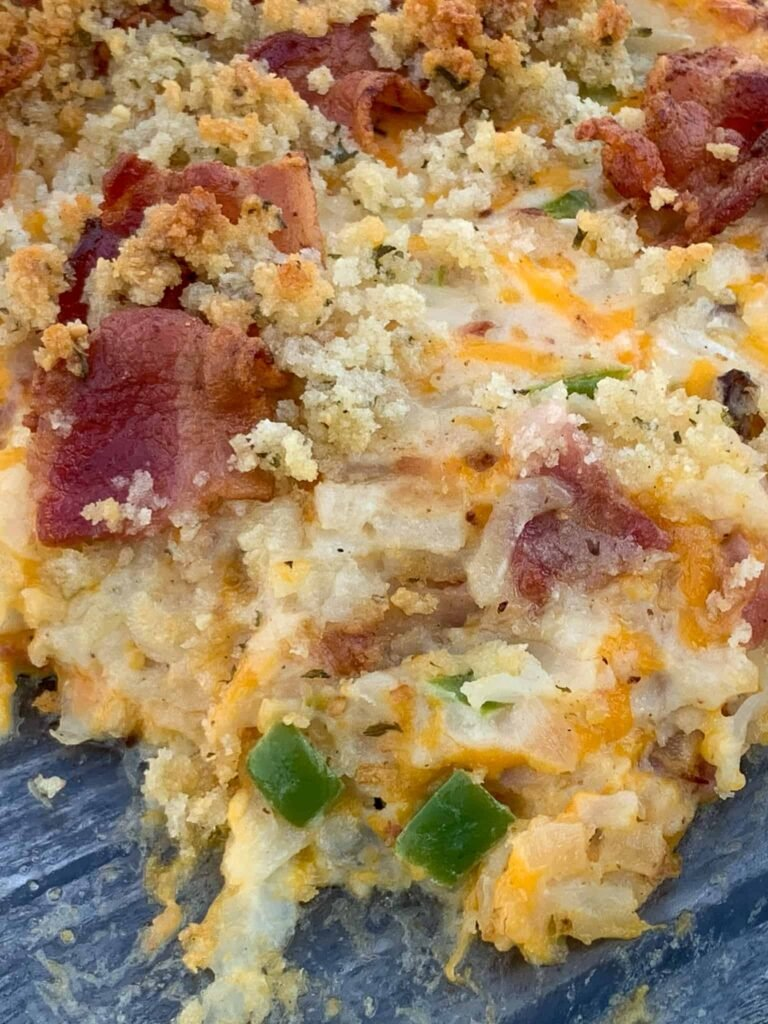 Southwest loaded potato casserole with bacon, peppers and onions