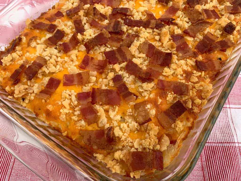 Cheesy hashbrown casserole with bacon and Ritz cracker crumb topping